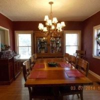 Formal Dining Area -Light fixture stays with home. Plenty of room for entertaining friends and family.